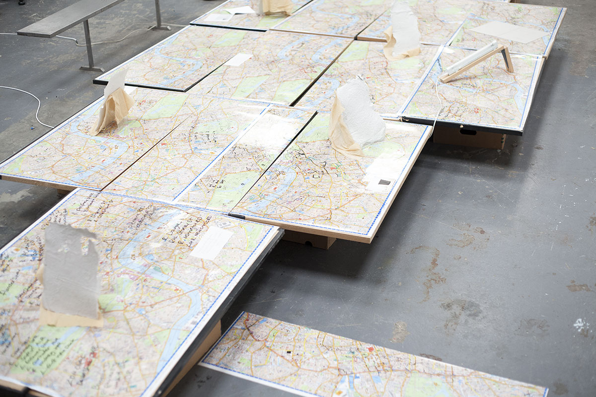 The beauties of DECOMPOSITION, 2017, exhibition view, Decomposition and Other Large Scale Works, UN8 London. Hand-made paper specimens displayed on annotated London maps and school desks from Taxi Driving School